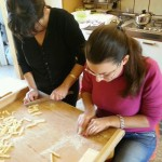 Mary working on homemade pasta during her cooking courses